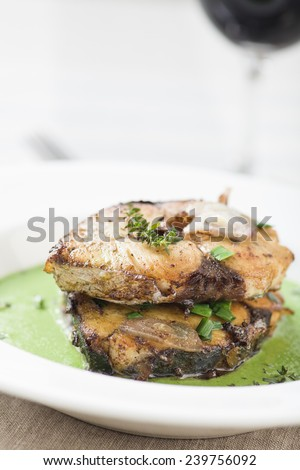 Fried mackerel with herb sauce and thyme - stock photo