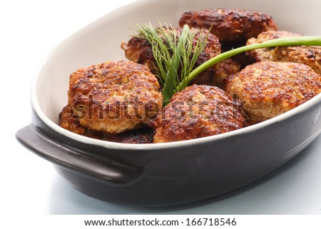 fried meatballs with herbs on white background - stock photo