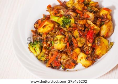 fried mixed vegetables with mushrooms - stock photo