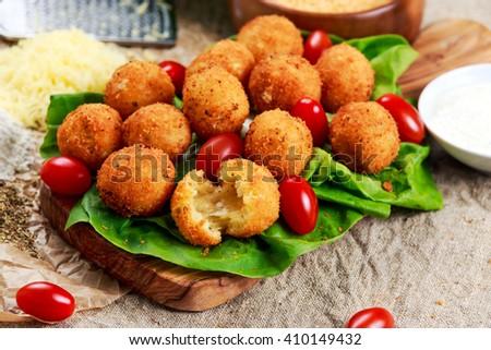 Fried mozzarella cheese stick balls - stock photo