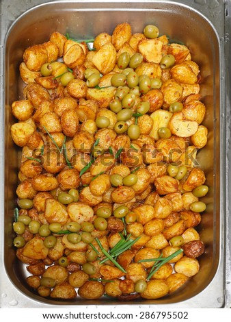 Fried New Potatoes With Olives And Herbs - stock photo