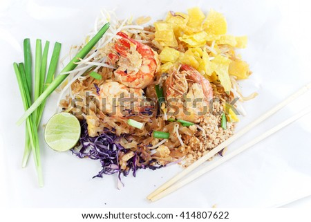 Fried noodle Thai style with prawns. Stir fry noodles with shrimp in (Pad Thai) Thai Cuisine on  white color wrapper food. - stock photo