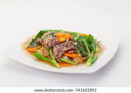 Fried noodle with pork and vegetable.