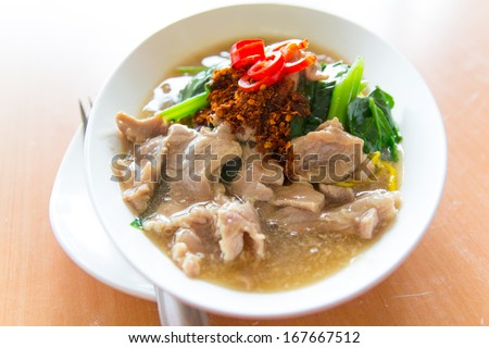 Fried noodle with pork, squid and shrimp soaked in gravy, Chinese food / Thai Style