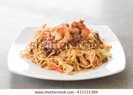 fried noodles with shrimp on table
