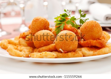 fried onion rings and cheese balls - stock photo