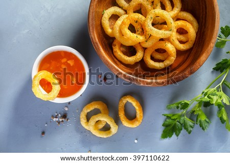Fried onion rings  in batter with sauce. Food background, Top view - stock photo