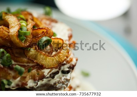 Fried onions with potatoes. Food concept. Macro image