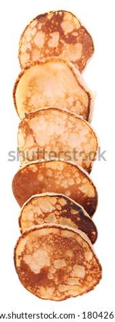 Fried pancakes isolated on white - stock photo