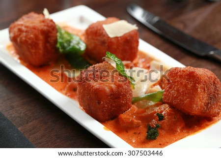 Fried Parmesan with tomato sauce - stock photo