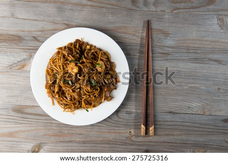 Fried Penang Char Kuey Teow top down view which is a popular noodle dish in Malaysia, Indonesia, Brunei and Singapore  - stock photo