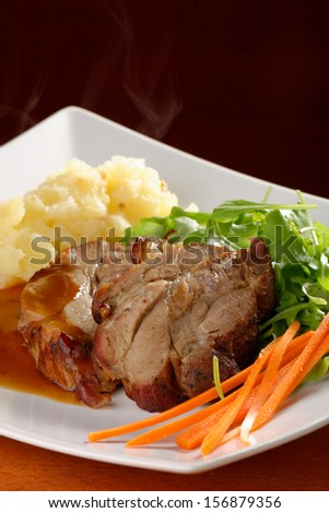 Fried pork chop, mashed potato and vegetable salad  - stock photo