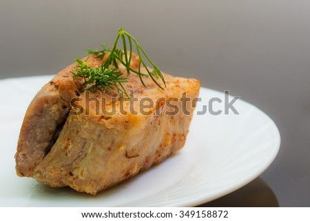 fried pork with a bread slice strewed with fennel