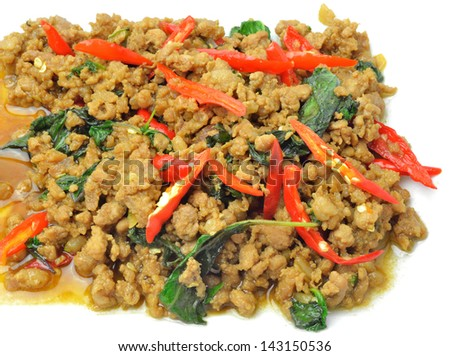 Fried pork with basil isolate on white background