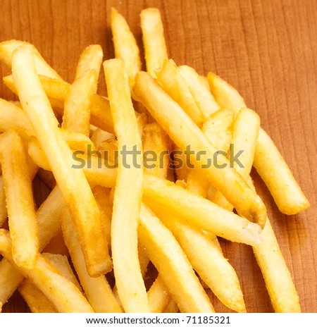 fried potato chips on a wooden surface - stock photo