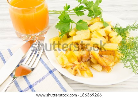 fried potato on a wooden background