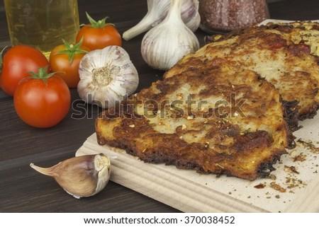 Fried potato pancakes with garlic. Traditional Czech food. Preparing homemade food. - stock photo