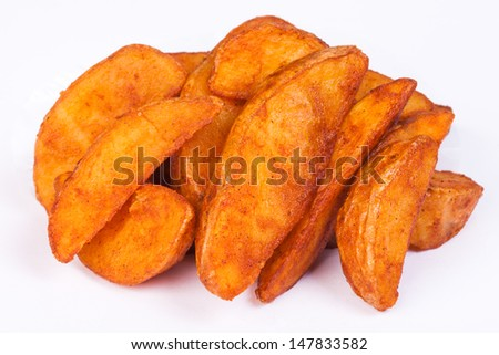 Fried potato wedges. Fast food. - stock photo
