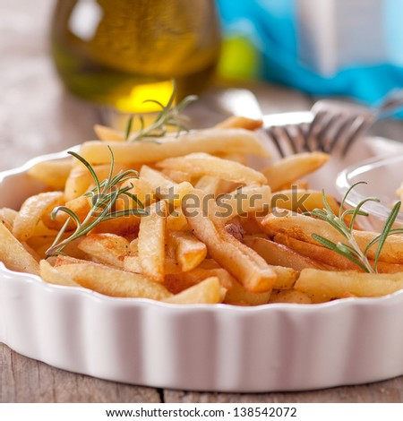 Fried potatoes with oil, selective focus - stock photo