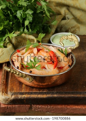 fried prawns with chilli in a copper pan, Indian style  - stock photo