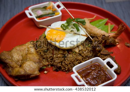 fried rice popular asian food with satay egg chicken and samba