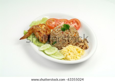 fried rice serve with chicken wing - malaysian food - stock photo