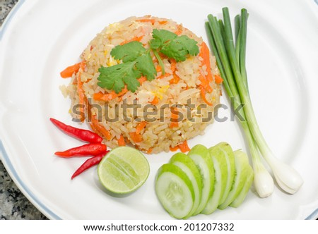 Fried rice with chicken on white plate