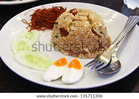 Fried Rice with Chinese Sausage, salty egg and sweet crispy fried pork - stock photo