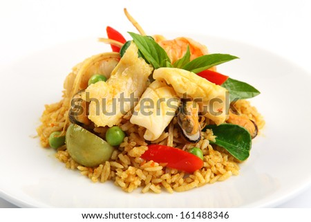 fried rice with green curry with seafood, Thai food - stock photo