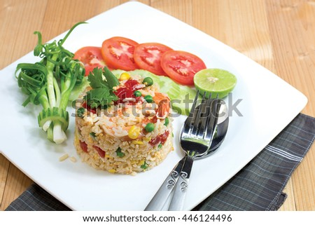 Fried rice with prawns on white dish, Thai food