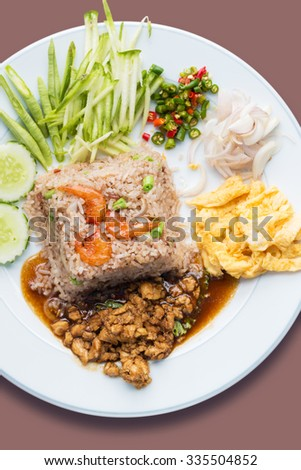 Fried rice with shrimp paste and side dishes. - stock photo