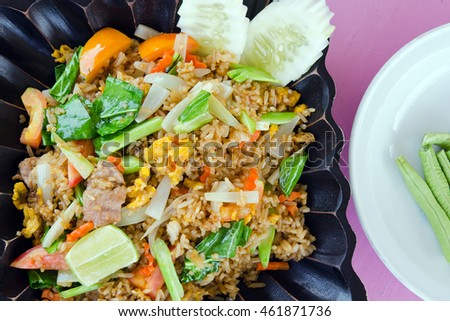 Fried rice with tomato, pork and vegetables - famous street rice food