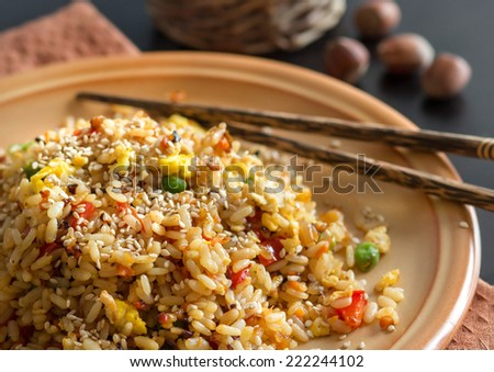 Fried Rice with Vegetables and fried eggs - Chinese Cuisine - stock photo