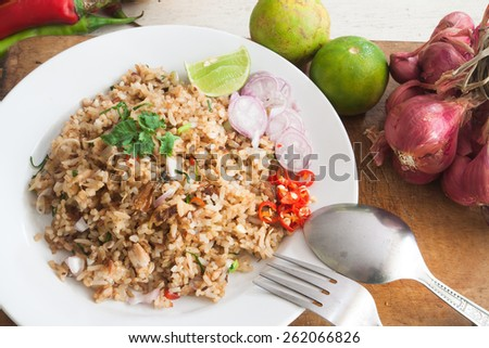 Fried rice with vegetables, herb and ingredients in Thai cuisine - stock photo