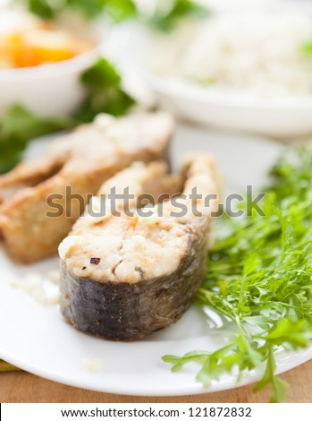 fried river fish fillets and parsley, close-up
