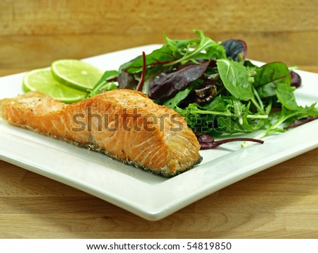fried salmon fillet with baby greens salad - stock photo