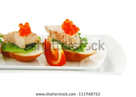 fried salmon on baguettes isolated over white