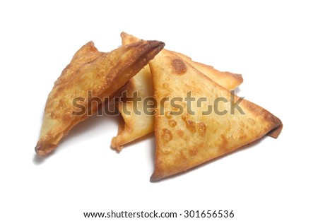 fried samosa snacks on white - stock photo