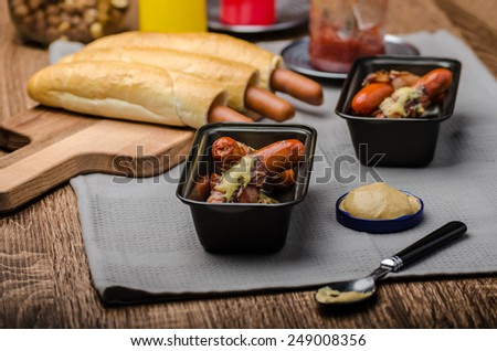 Fried sausage in a robe of bacon and cheese, hot dog, czech - stock photo
