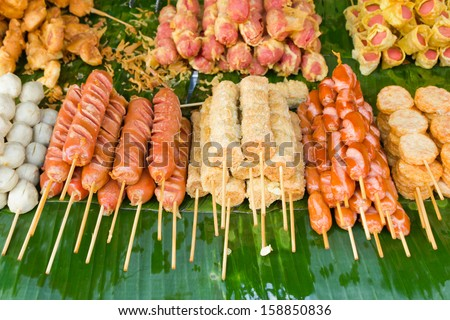 fried sausages and fried meatballs sold in the fresh markets, Thailand - stock photo