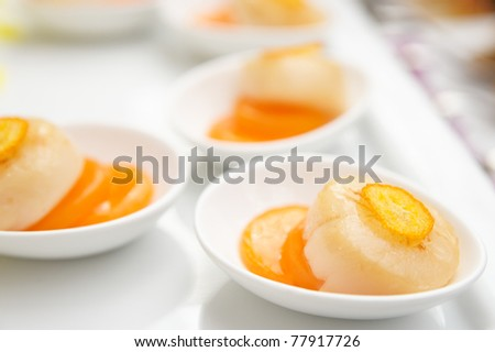 Fried scallops with orange jam on plate, closeup - stock photo