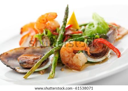 Fried Seafood Salad with Lemon Slice and Asparagus - stock photo