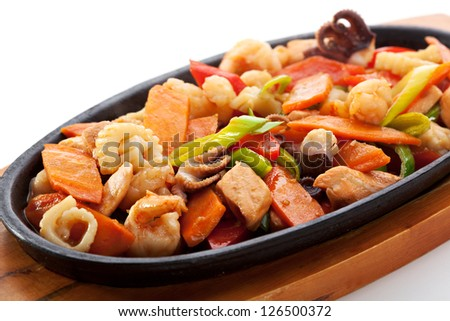 Fried Seafoods - Salmon, Shrimps, Mussels and Calamari Rings - stock photo