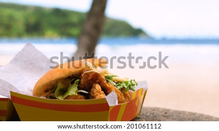 Fried shark and bake fast food by the beach at Maracas Bay - stock photo