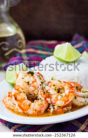 Fried shrimp in sauce with white rice and lime, tasty snack - stock photo