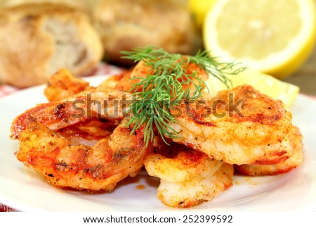 fried shrimp on a plate with lemon and dill - stock photo