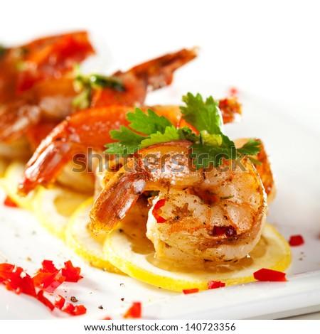 Fried Shrimps on Lemon Carpaccio with Sauce - stock photo