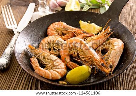 fried shrimps with lemon - stock photo