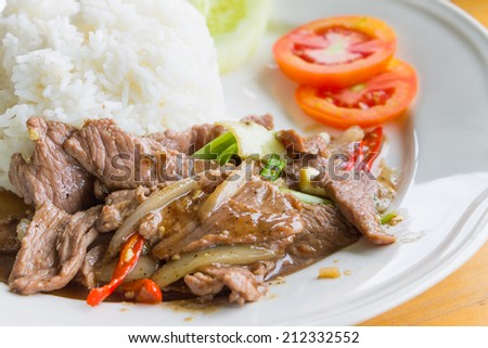 Fried sliced beef with garlic , Thai food