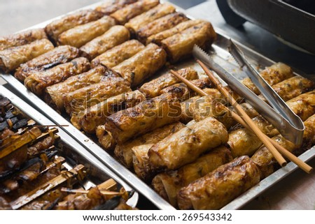 "Fried spring roll - the ingredient of ""bun cha"" is the famous vietnamese noodle soup with bbq meat, spring roll, vermicelli and fresh vegetable served on bamboo flat basket - stock photo"
